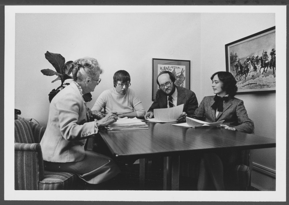 Bulletin of the Menninger Clinic editorial staff in Topeka, Kansas - This photograph from the 1980's shows, left to right, Virginia Eicholtz, Melba Ludvicek, Phil Beard, and Mary Ann Clifft.