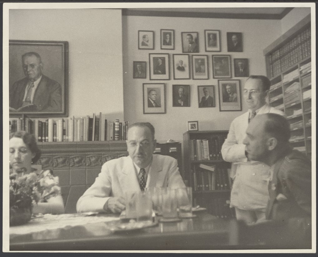 Menningers - Dr. Karl and Dr. Will are shown at 'Afternoon Tea',  a daily tradition at the Menninger Clinic.  John Stone is standing in this photograph taken in 1937 or 1938.