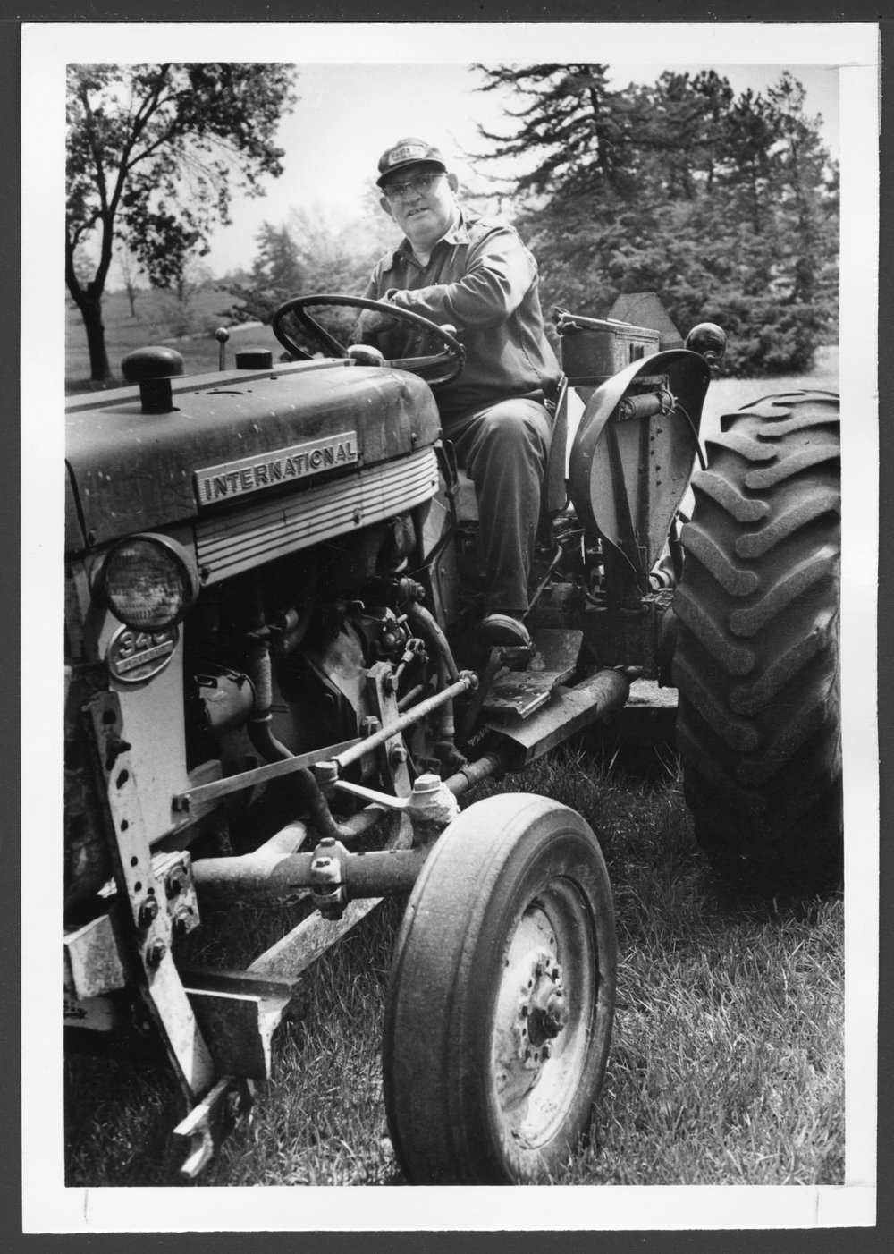 Plant Operations staff at Menninger Clinic, Topeka, Kansas - Ray McMillan on the International tractor.