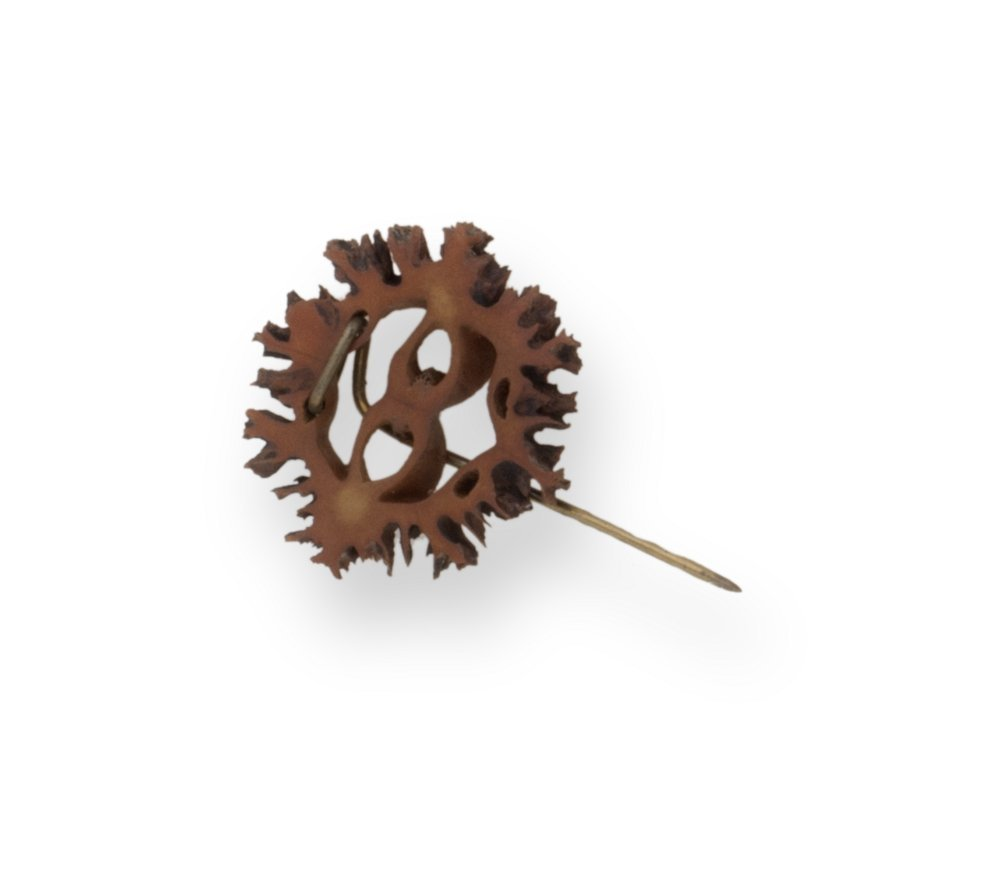 Carved butternut pin