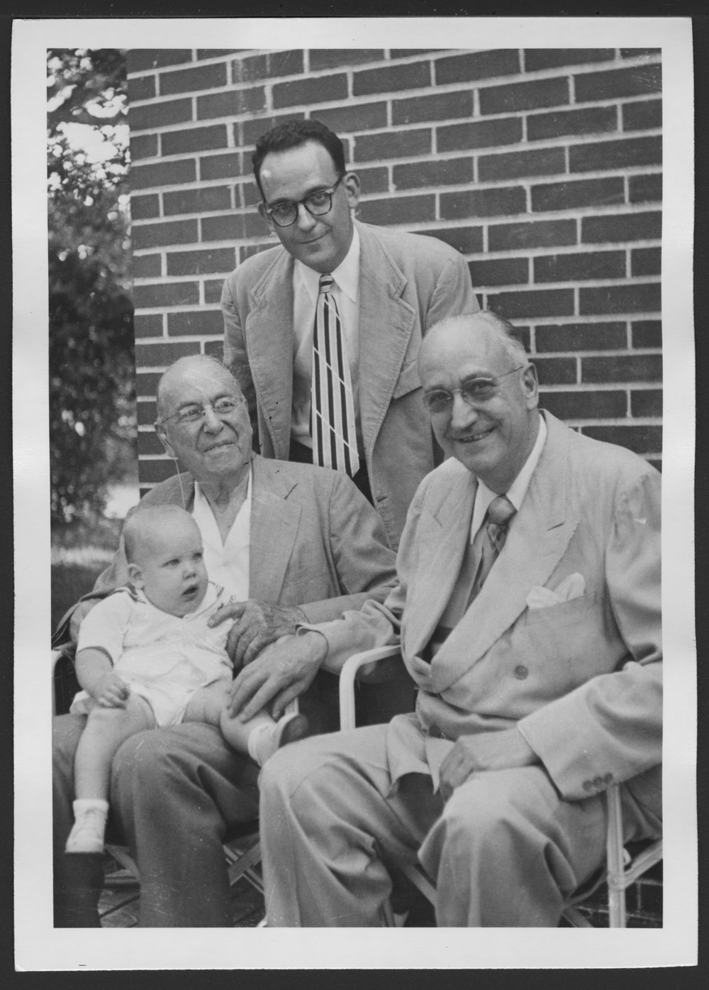 Karl A. Menninger, M.D. - Four generations of Menningers:  Karl Menninger, Jr., seated on the lap of his great grandfather, Dr. C.F. Menninger, Robert Menninger (standing) and Dr. Karl in 1952.