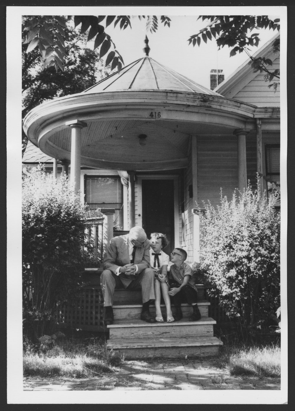 Karl A. Menninger, M.D. - Dr. Karl with his daugher Rosemary and grandson Karl II in front of the house where Dr. Karl was born, 1270 Topeka Blvd.