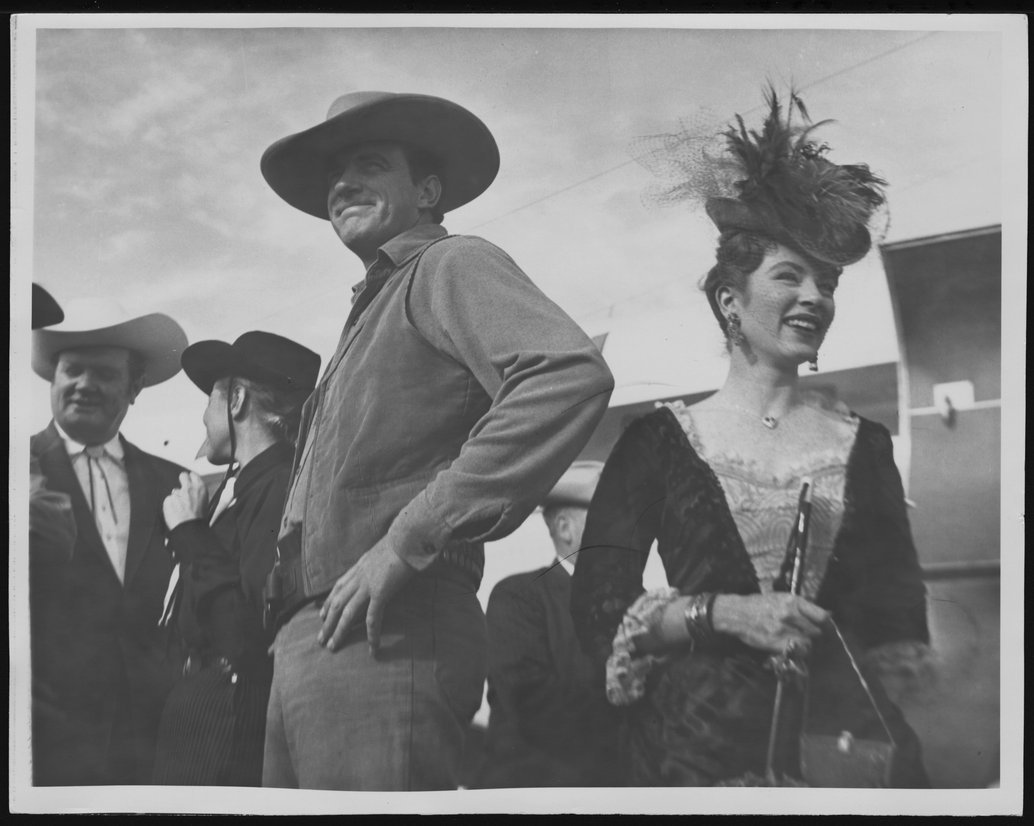 'Gunsmoke' cast members at a Kansas Centennial event - James Arness and Amanda Blake after deplaning at an unidentified airport.  *163