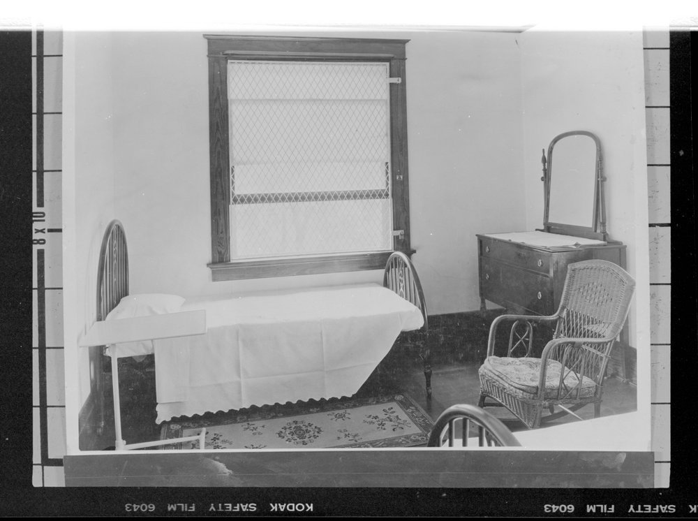 Interior views of the early Menninger Sanitarium in  Topeka, Kansas - A patient's bedroom.