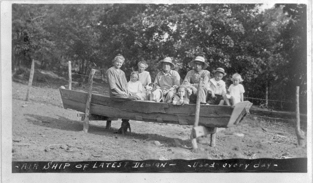 Family in rowboat, Bourbon County, Kansas
