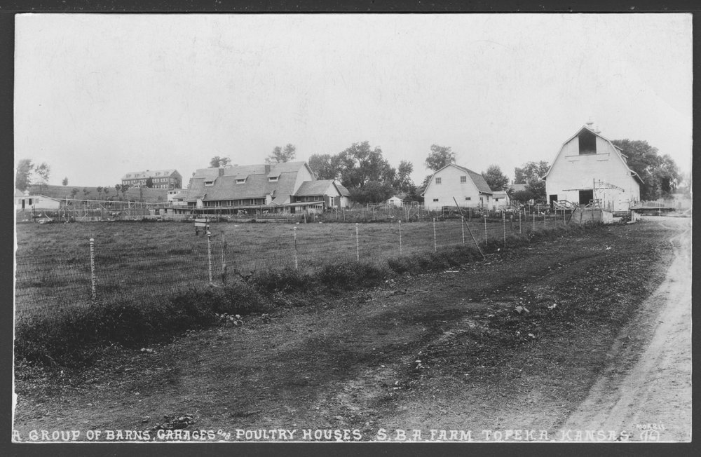 Security Benefit Association farm and hospital complex in Topeka, Kansas - A postcard showing the group of barns, garages and poultry houses on the model S.B.A. (Security Benefit Association) farm. In the distance, to the left, the old folks' home can be seen. (later called the  Neiswanger building).