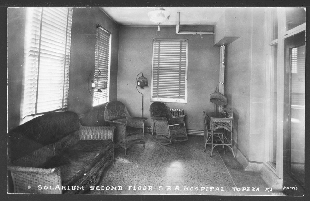 Security Benefit Association farm and hospital complex in Topeka, Kansas - A solarium on the second floor of the hospital.  Note the bird cages.