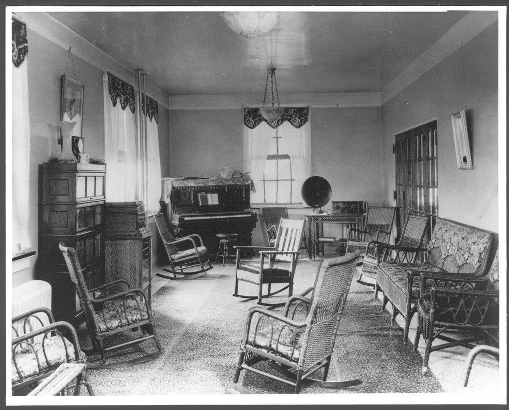 Security Benefit Association farm and hospital complex in Topeka, Kansas - This is the living room in the Dean building, the retirement home for S.B.A. members.  Eight rocking chairs!