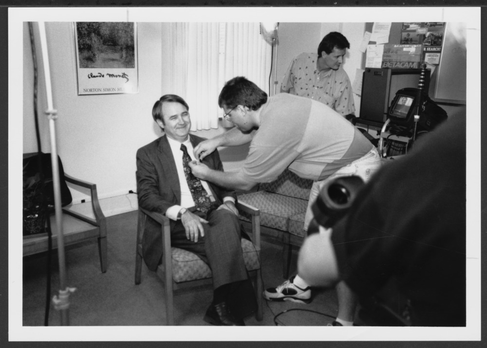 Menninger photograph collection - #1854, Gary Napier, RN, being miked for an interview, 1994