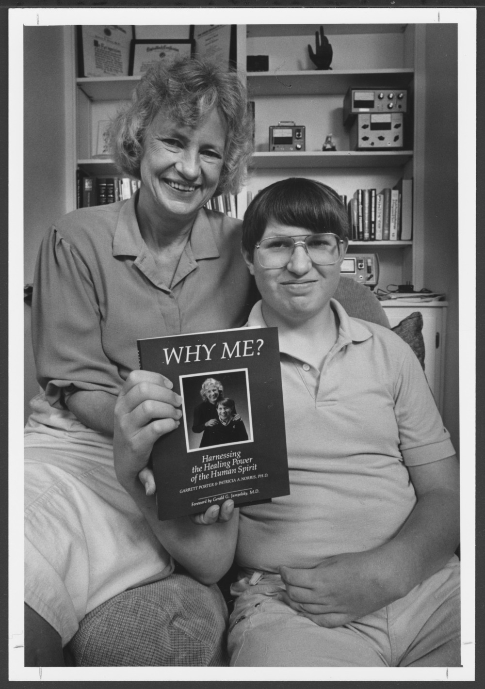 Menninger photograph collection - #1887 Patricia Norris, PhD, and Garrett Porter with the book they co-authored, 1985