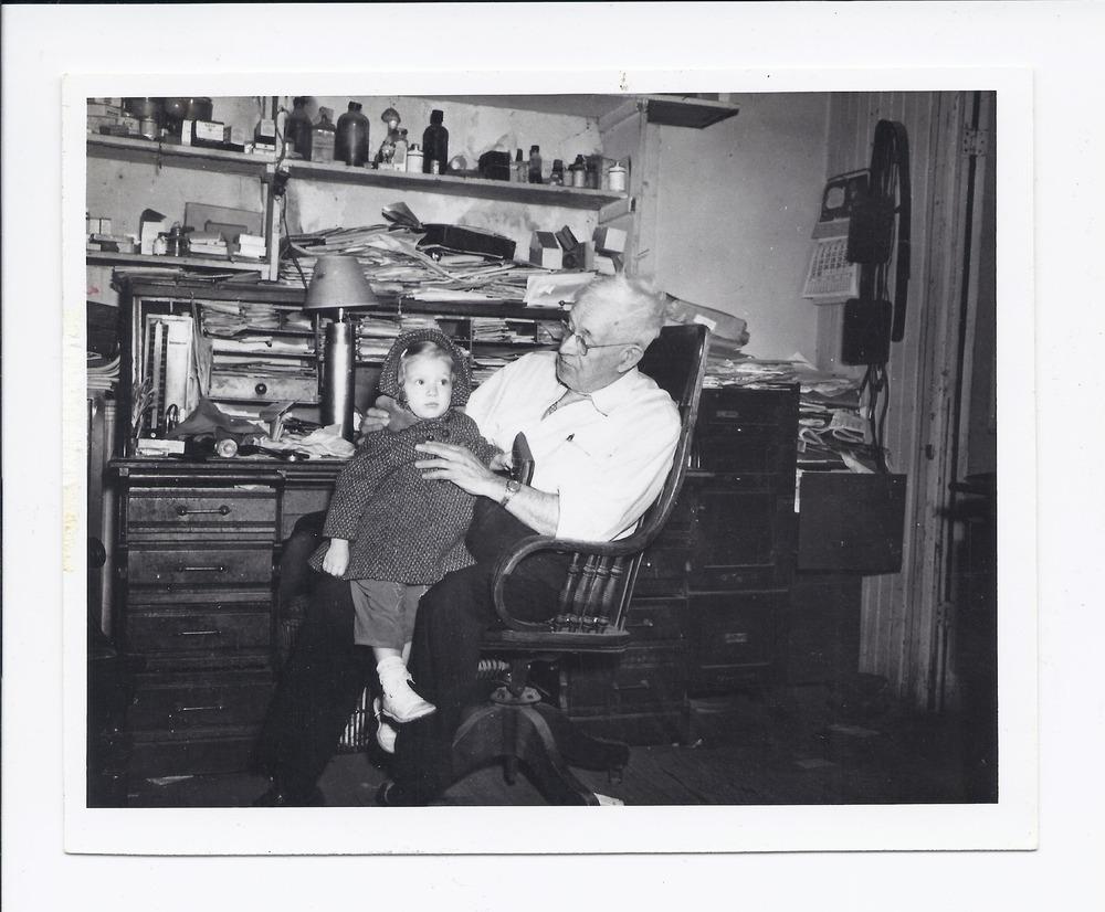 Dr. Henry B. Miller holding Shelley McClain, Rossville, Kansas - 1