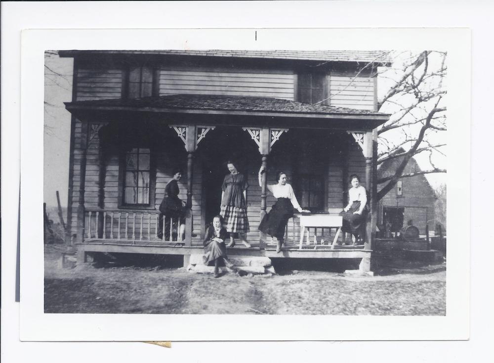 A group of women on a porch, Rossville, Kansas - 1