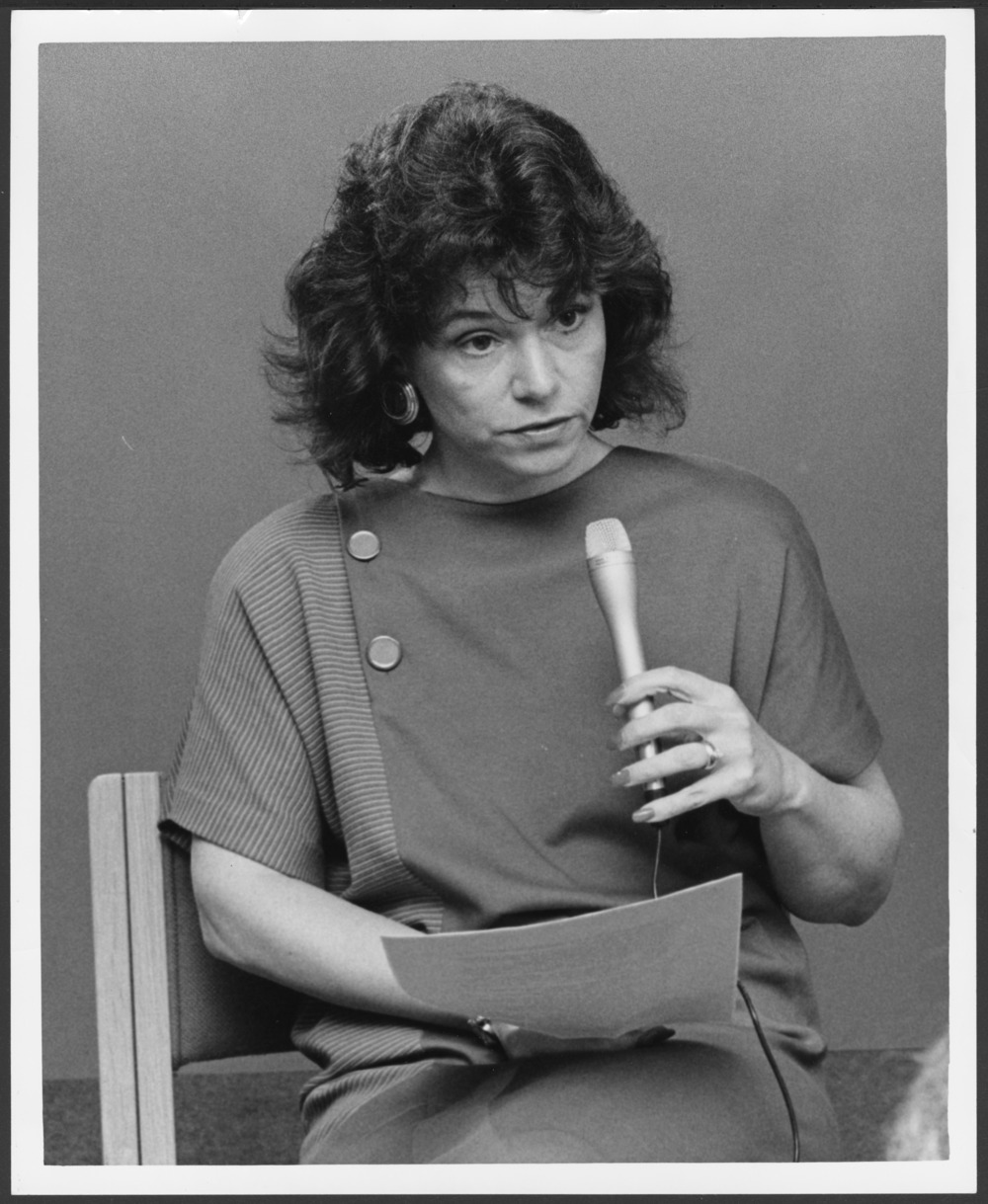 Menninger photograph collection - View of Dr. Meredith Maxifeld Titus holding a microphone. Envelope #2545