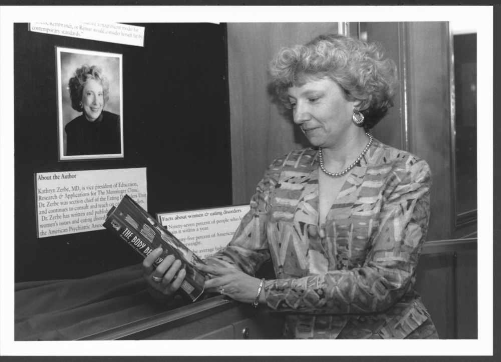 Menninger photograph collection - View of Dr. Kathryn Zerbe holding a book.  Envelope #2785