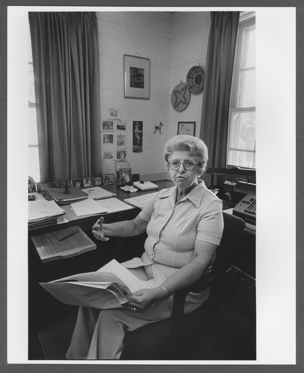 Menninger photograph collection - A photograph Dr. Lolafaye Coyne at her desk.  The photograph was taken by Hank Young.  Envelope 688