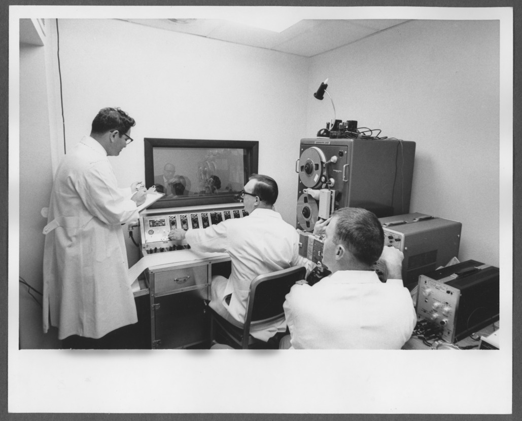 Howard Shevrin, M.D., with research equipment at the Menninger Foundation Topeka, Kansas