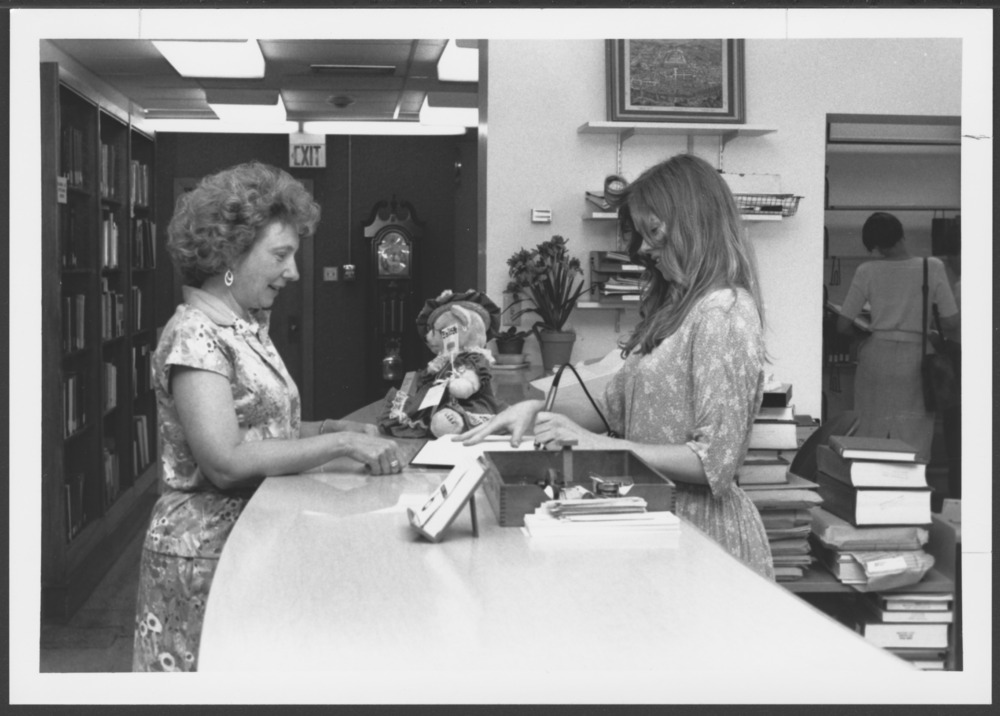 Menninger photograph collection - A photograph of Kathryn Zerbe and Liz Furse in the library.  Envelope 432