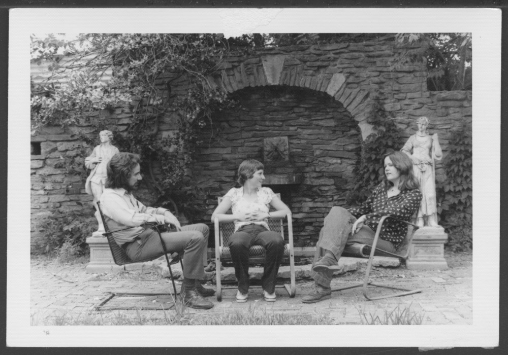 Menninger photograph collection - A photograph showing three people seated in the garden, c.1979.  Envelope 433