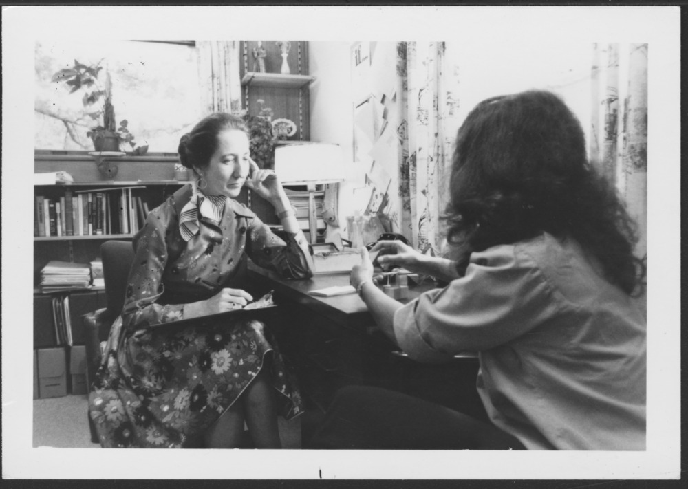 Menninger photograph collection - A photograph of Mary Cerney with a woman in the examination phase, c.1979.  Envelope 433