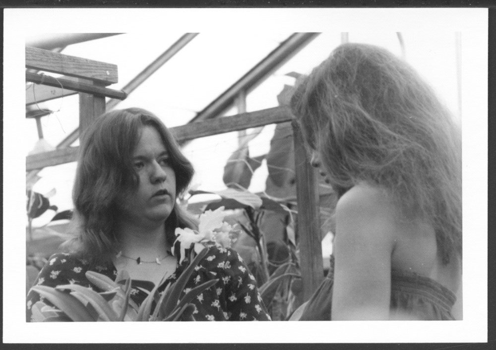 Menninger photograph collection - A photograph of two women with an orchid, c.1979.  Envelope 433