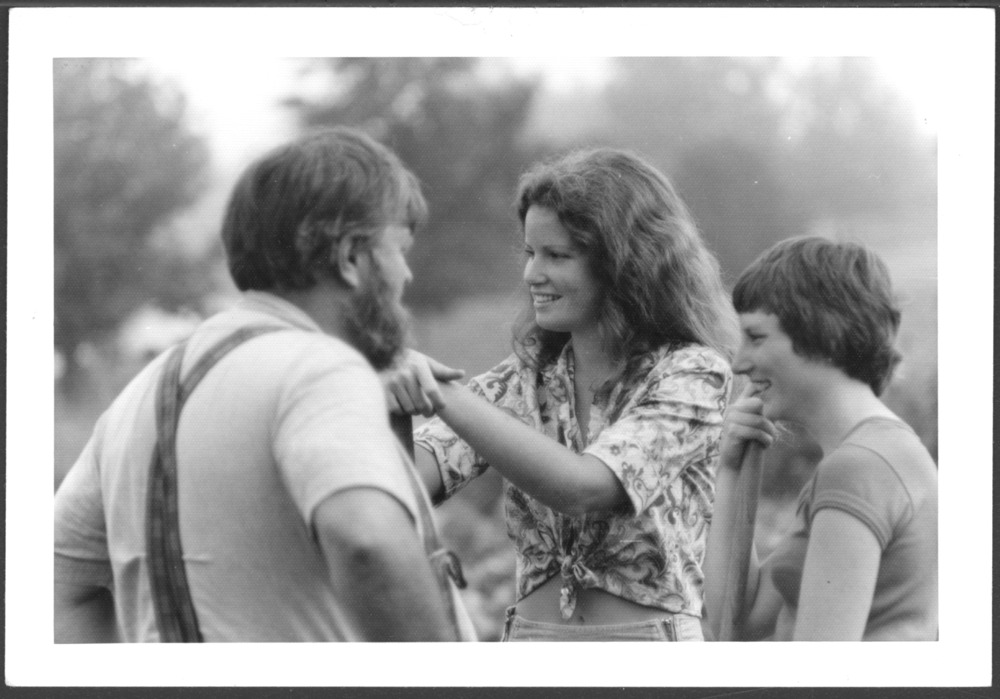 Menninger photograph collection - A photograph of a man and two women in a garden, c.1979.  Envelope 433