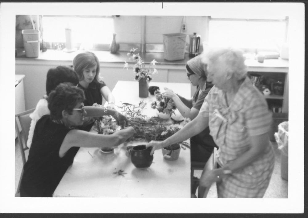 Menninger photograph collection - A photograph of women making flower arrangements, c.1979.  Envelope 433