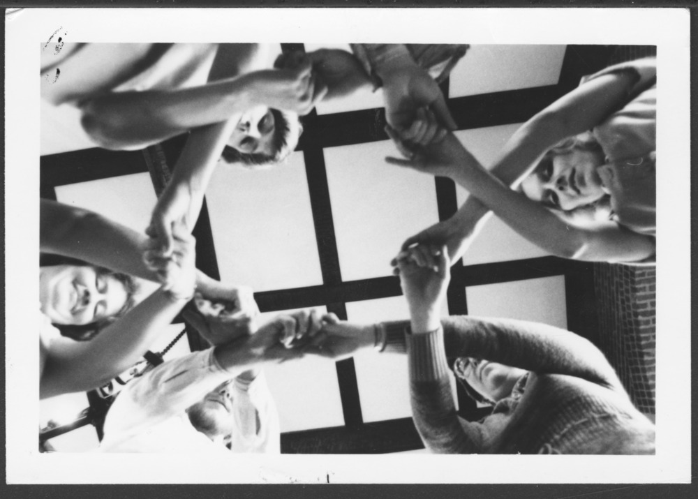 Menninger photograph collection - A photograph of a group holding hands, c.1979.  Envelope 433