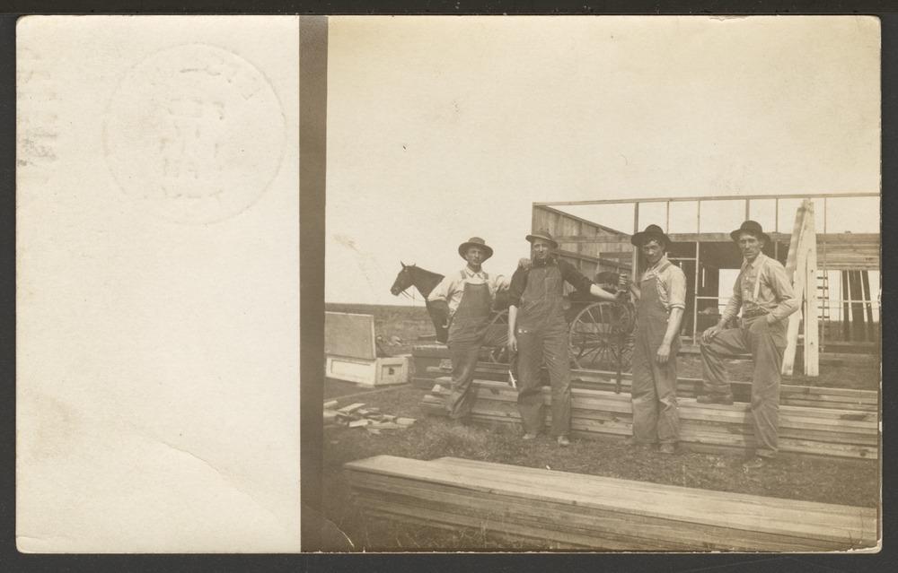 Men constructing a building - 1
