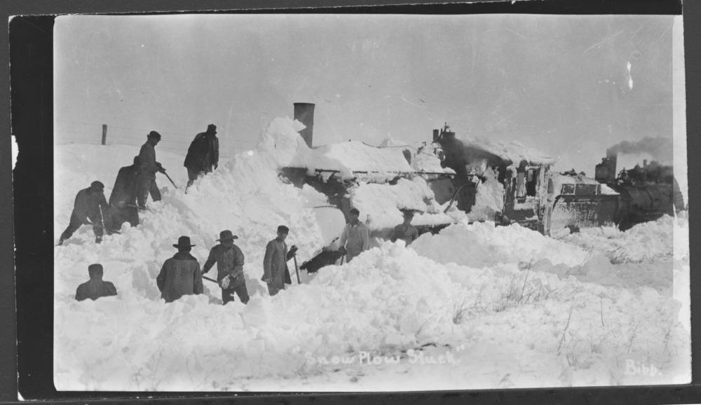 Railroad snow plow stuck in a drift