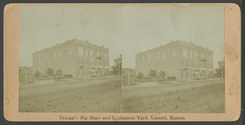 Doerr's Big Store in Larned, Kansas - Exterior view of Doerr's Big Store and implement yard.  *2