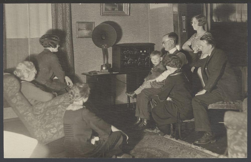 A. D. Birch listening to a radio in Topeka, Kansas