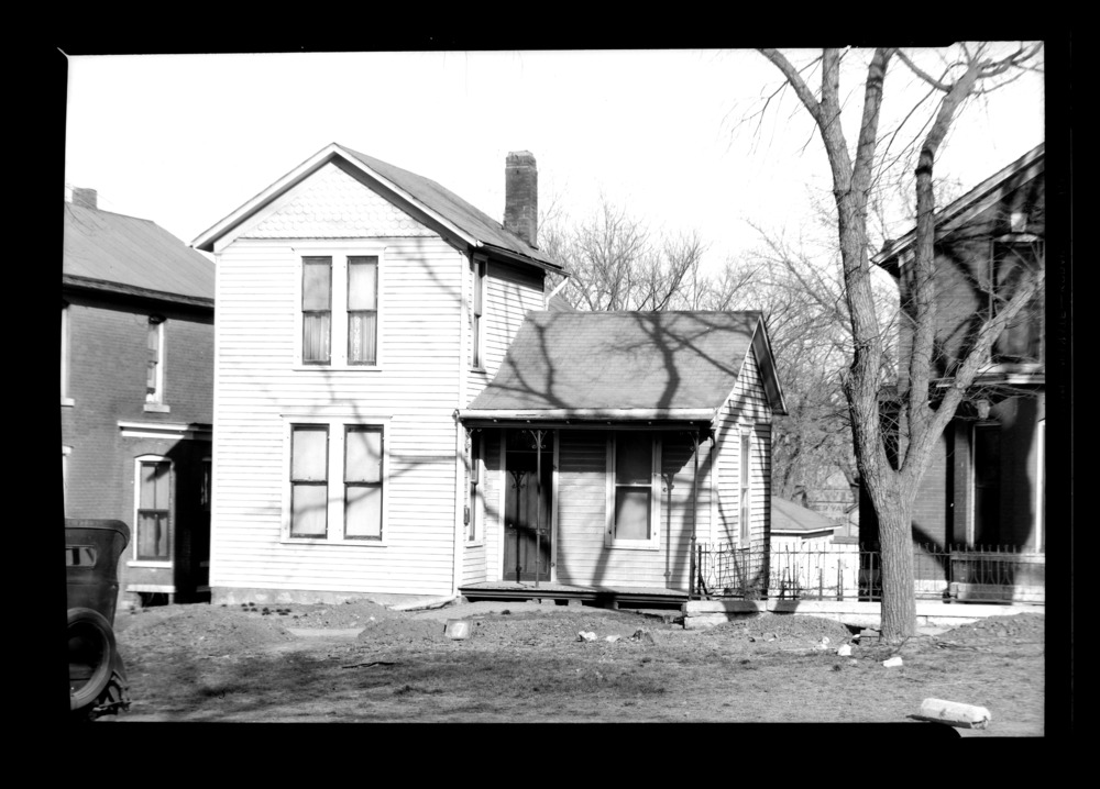 Homes and businesses in the area near the future site of the Topeka Boulevard bridge in Topeka, Kansas - This photograph shows a house owned by Mr. Vincent M. Christian located at 126 Topeka Boulevard.  It was taken on April 6, 1935. *7