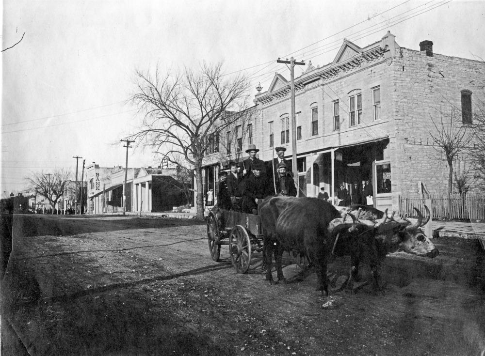 John Hasenbank driving a team of oxen on Missouri Street, Alma, 1910