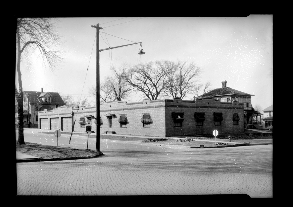 Homes and businesses in the area near the future site of the Topeka Boulevard bridge in Topeka, Kansas - This photograph shows the Kansas Emergancy Relief Committee Transient Hospital. The hospital is located at 135 Southwest Topeka Boulevard, on the southside of the bridge.  This photograph was taken on April 6, 1935. *2