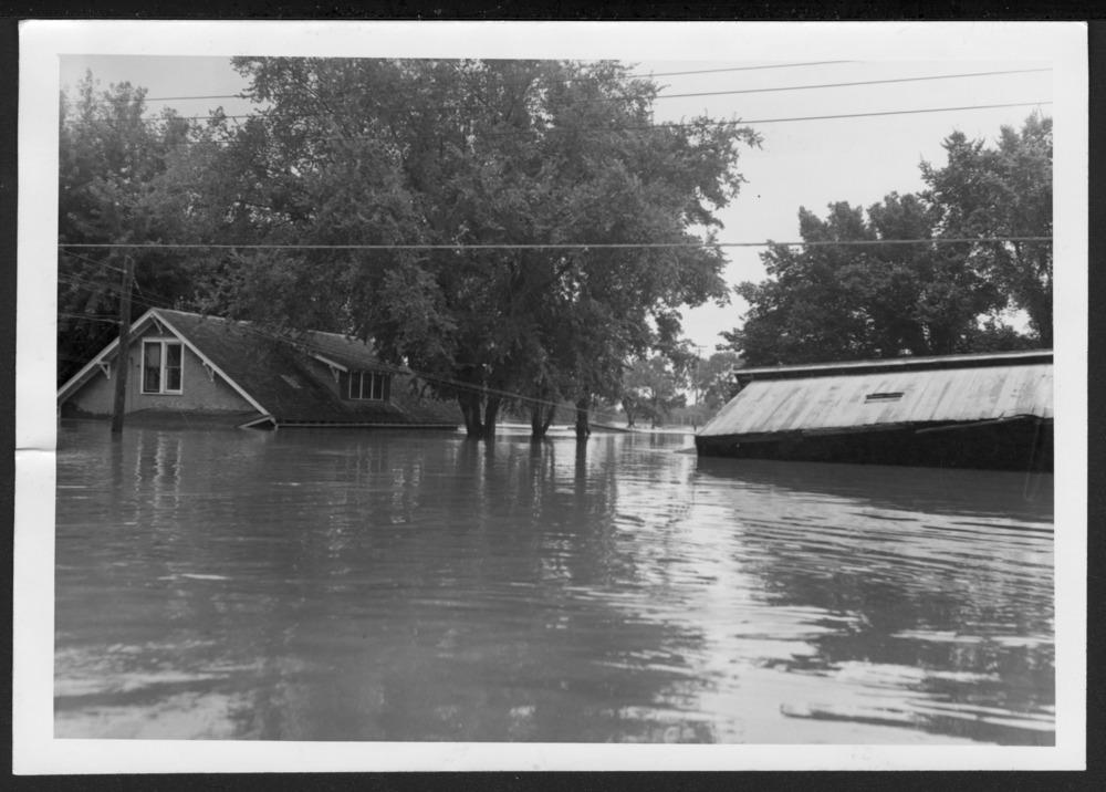 Allen County, Kansas, floods--1951 - Dick Fry's home under flood water. *40