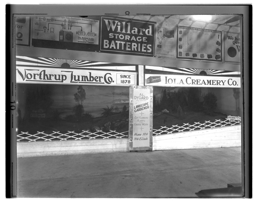 Allen County fair exhibits, Allen County, Kansas - Northrup Lumber Company, Iola Creamery Company, and Dygard Florist fair exhibits. *2