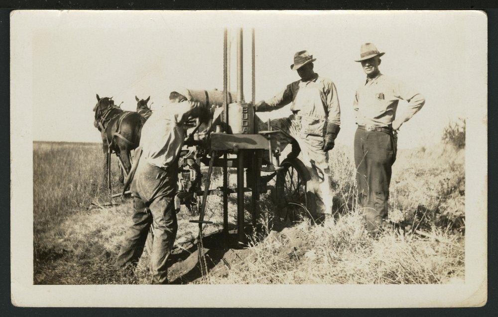 Drilling a hole for an electric pole near Solomon, Kansas - 1