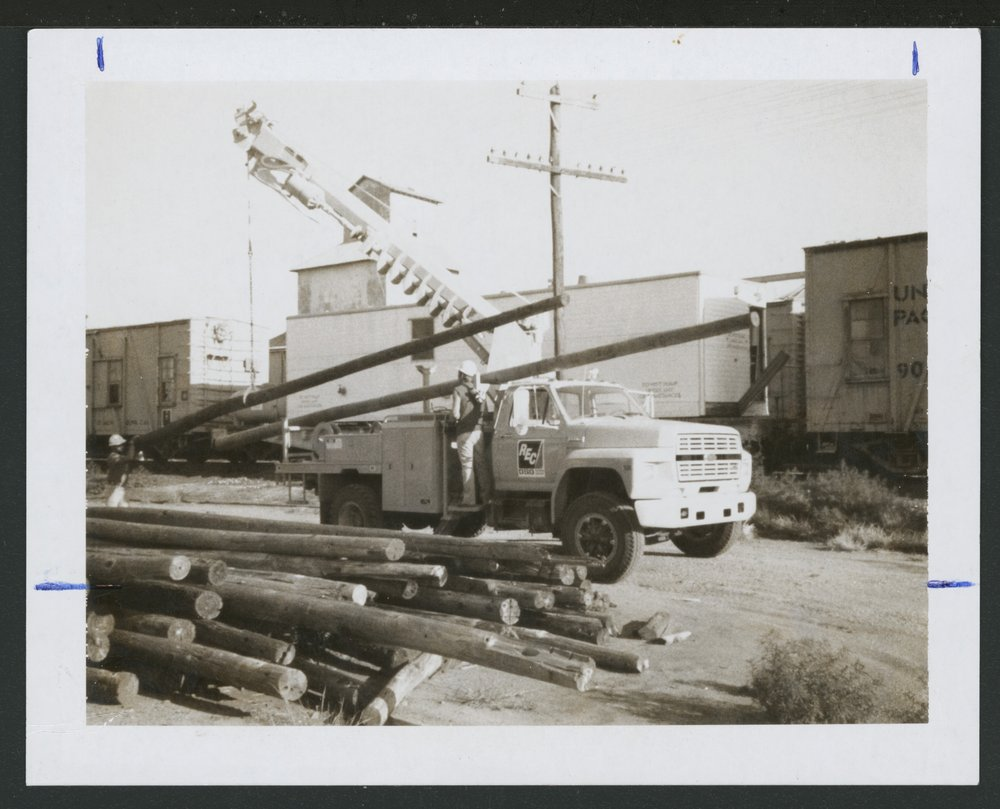 DS&O Rural Electric Cooperative's truck with a pole digger
