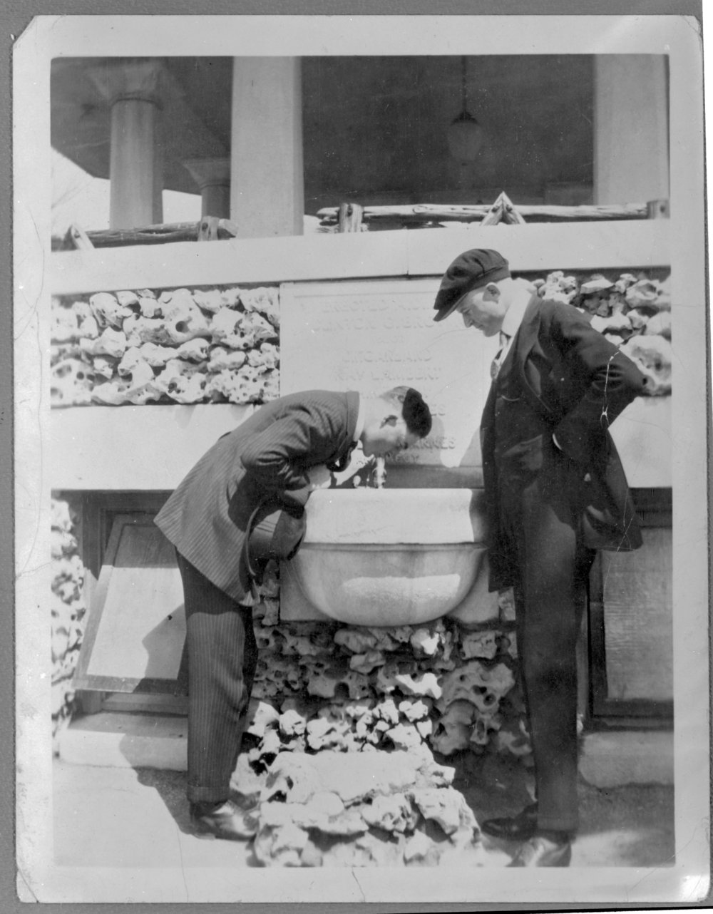 Virgil Barnes in San Antonio, Texas - Barnes is drinking from the water fountain in this photo. The man watching him is unidentified. (*13)
