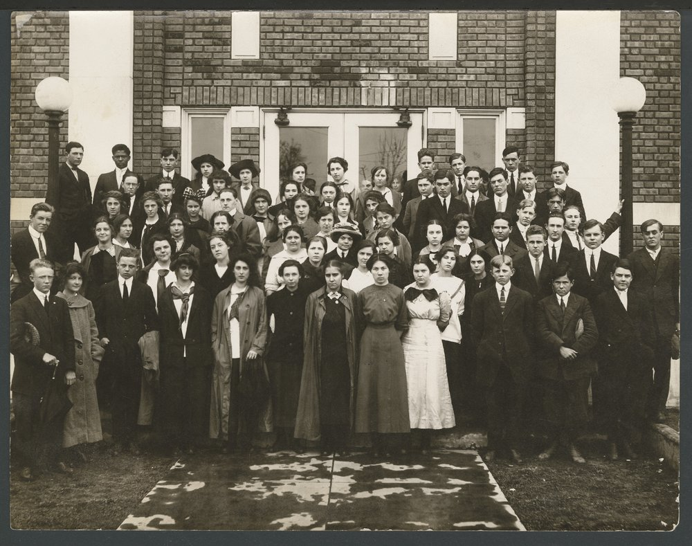 Students in front of a building, possibly in Liberal, Kansas