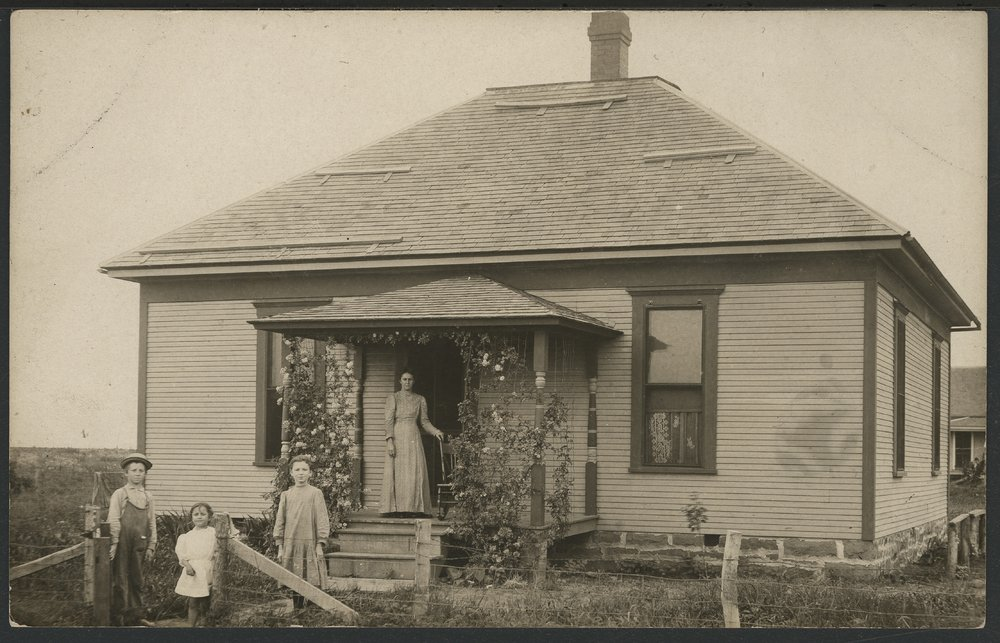 Unidentified family with their house