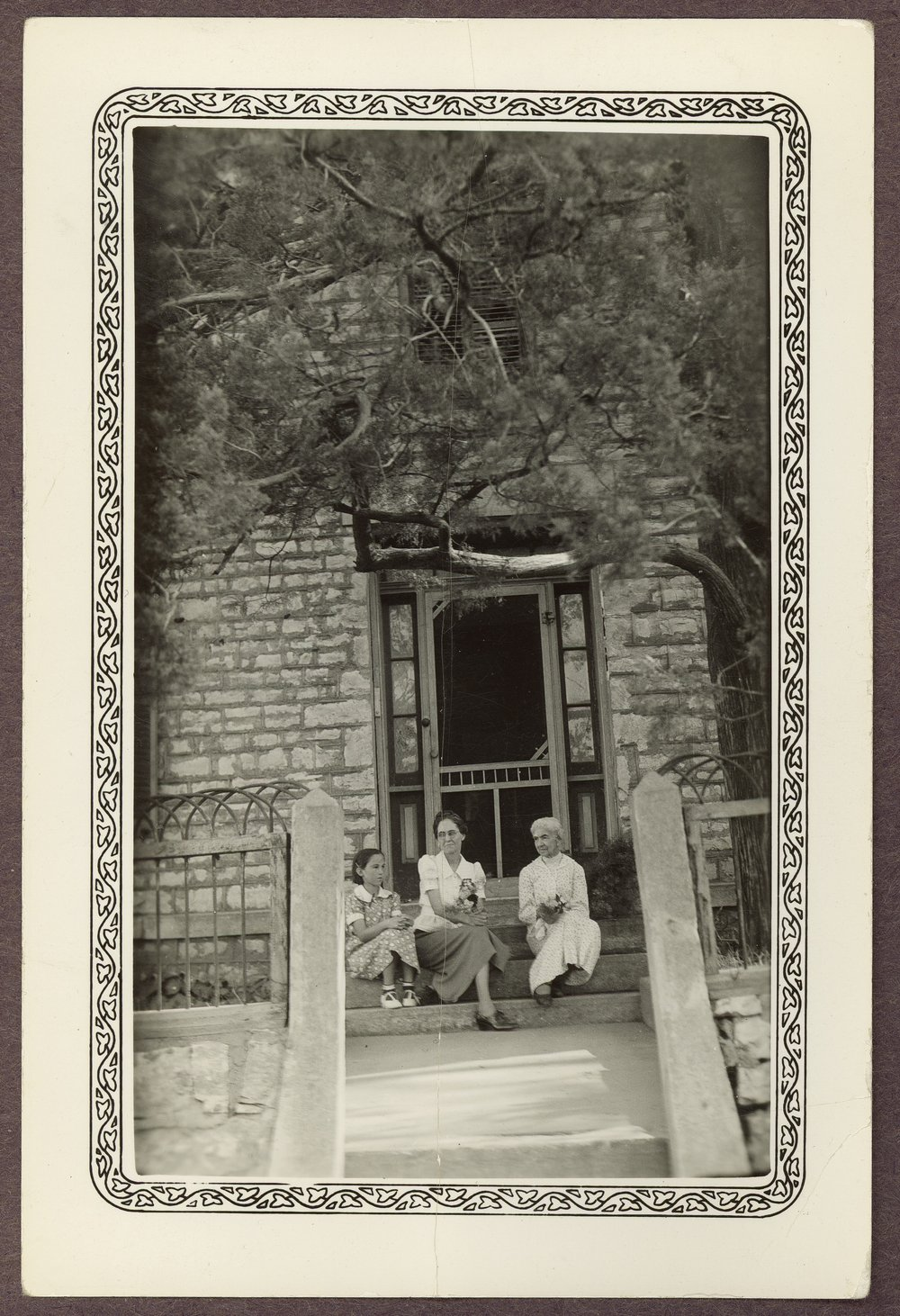 Isaac Goodnow residence, Manhattan, Kansas - 3 *13 On the front steps of the Goodnow home