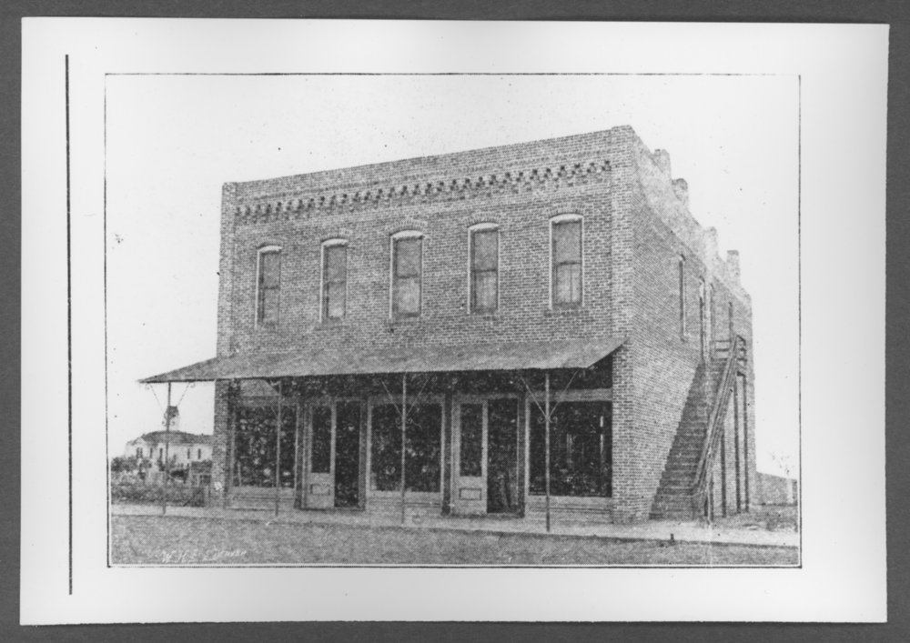 Scenes from Sherman County, Kansas - Leonard Building on the east side of Main, between 9th and 10 streets.