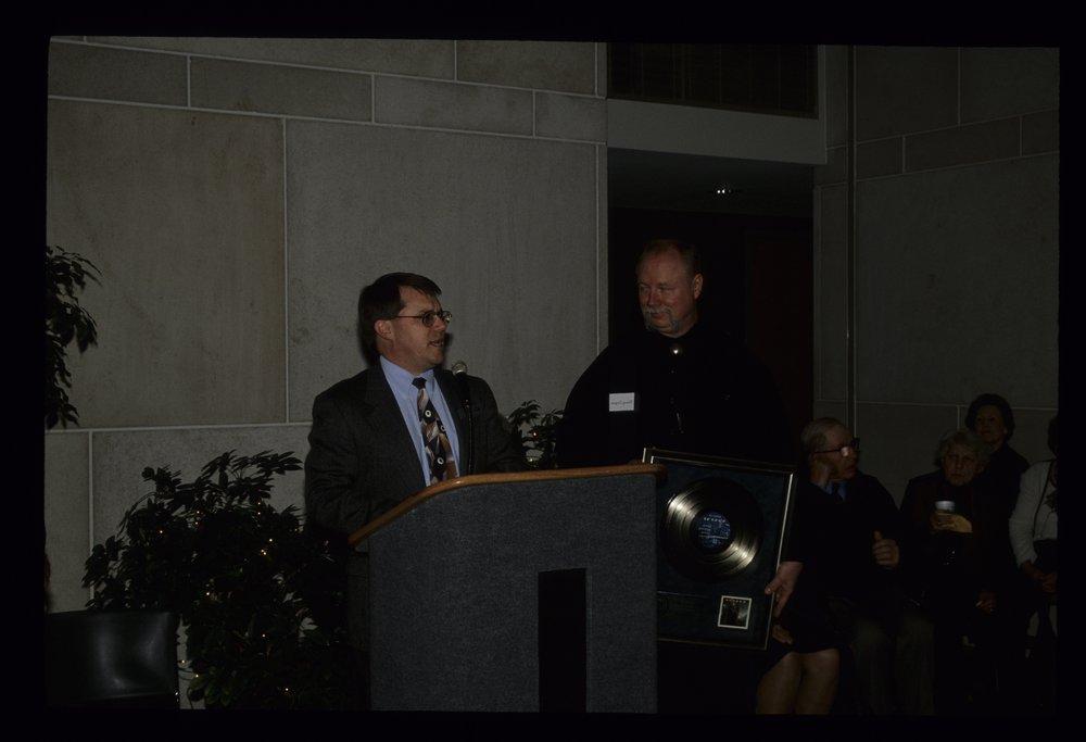 Kerry Livgren presenting his platinum record to Kansas State Historical Society - 4