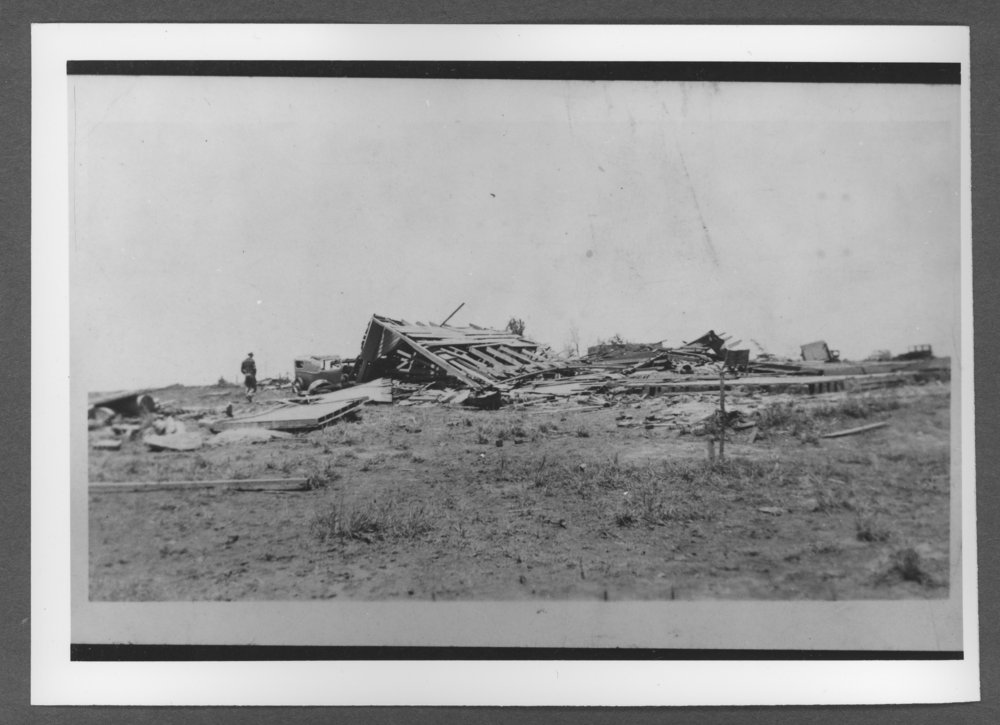 Scenes of Sherman County, Kansas - School bus storage building after a tornado, Ruleton, Kansas.