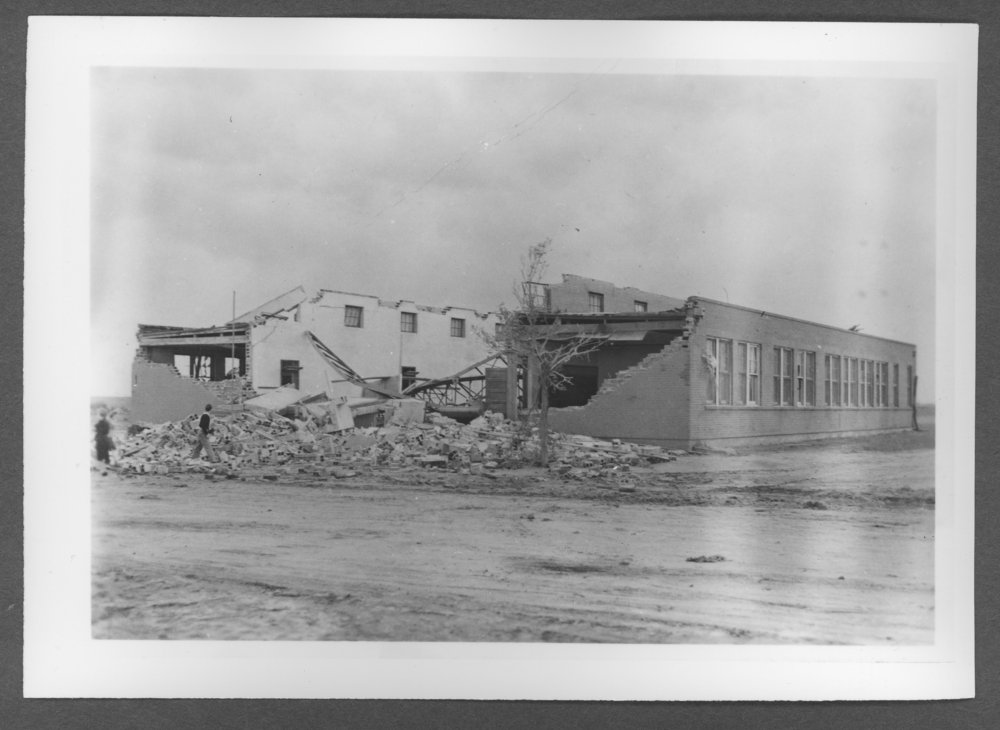 Scenes of Sherman County, Kansas - Tornado damage to a brick school house in Ruleton, Kansas, June 8, 1941.