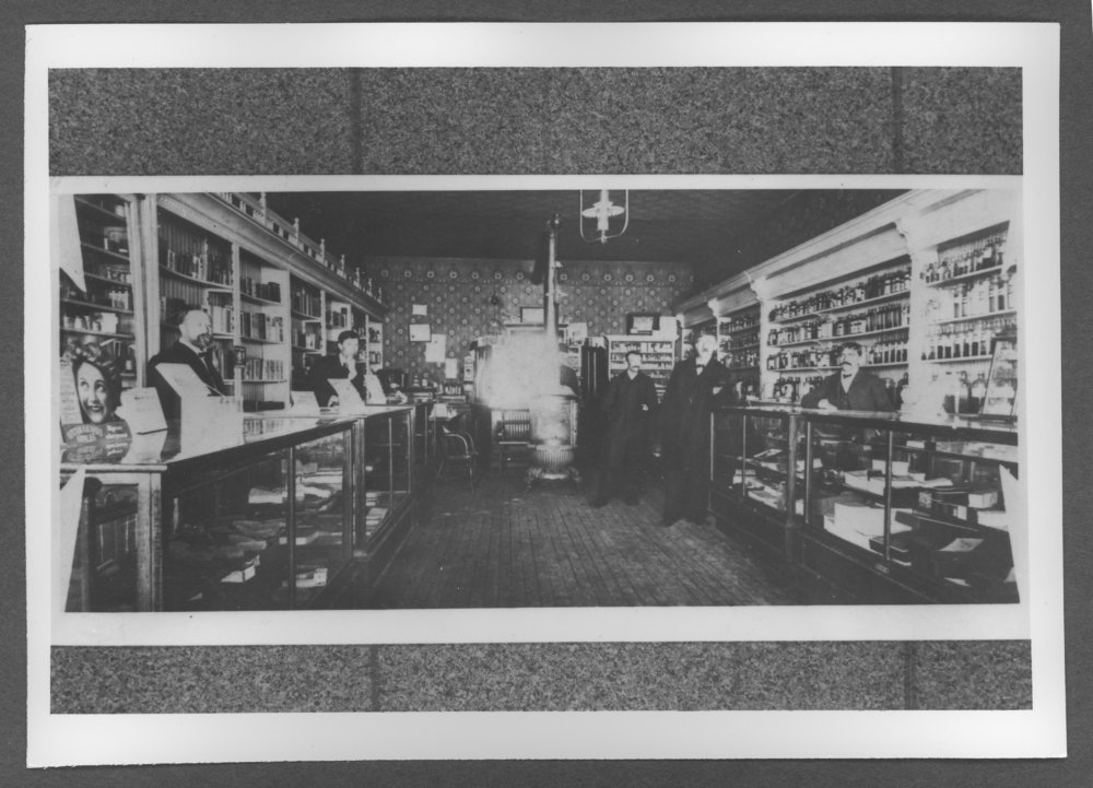 Scenes of Sherman County, Kansas - Cullin's Drug store.  Left to right: Jim Cullins, Dr. A.C. Gulick, Lloyn Weaver, Mart Cuthbertson, and Louie Arensburg.