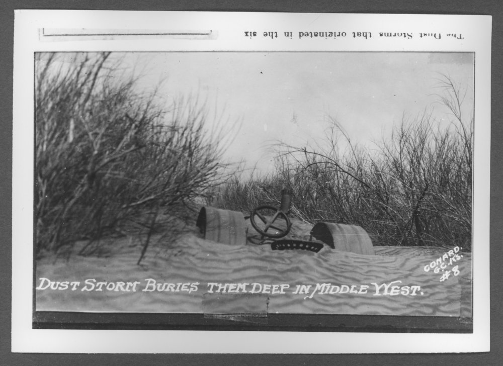 Scenes of Sherman County, Kansas - Tractor buried in dust. Photograph by Conard, a photographer from Garden City.