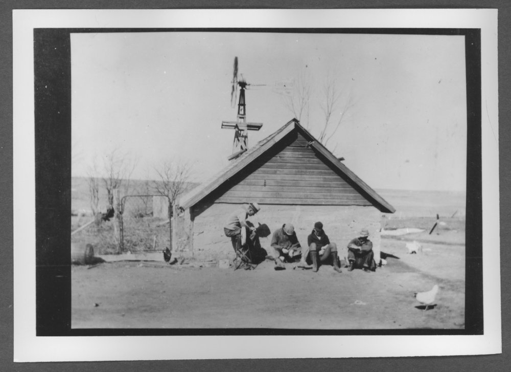 Scenes of Sherman County, Kansas - Milk house at the Bert Perkins farm.  Pictured left to right are Ralph, Frank, Dale, and Bert.