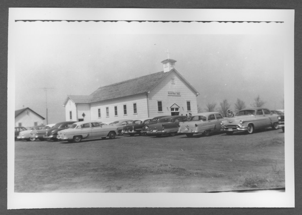 Scenes of Sherman County, Kansas - Cars parked at the Pleasant Hope Church.